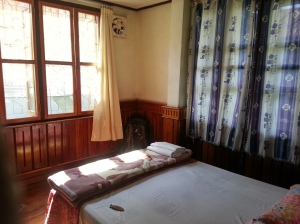 A cheap, but very nice, wooden guesthouse room in Laos