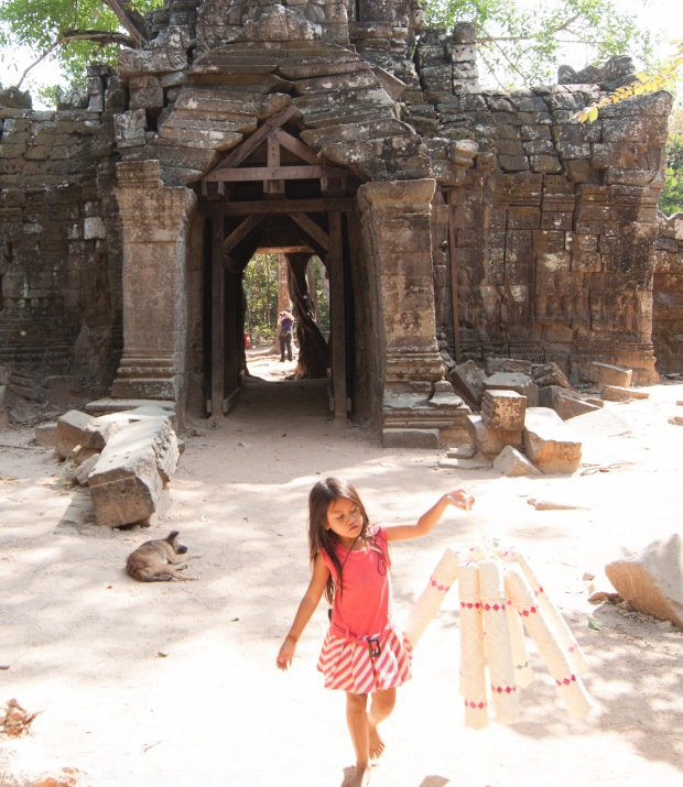 Child selling souvenirs in Angkor Wat